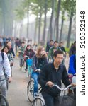 Small photo of BEIJING - OCT 18, 2013: a Caucasian female in the bicycle traffic jam in Tsinghua University, the top university in mainland China, loosening its restriction in recent years for foreign students.