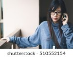 Asian Girl Listening To A Call...