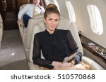 Small photo of woman in corporate jet looking to camera - airline business shooting