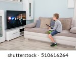 kid with remote control sitting ... | Shutterstock . vector #510616264