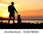 Silhouettes Of Soldier And Dog...
