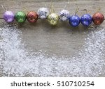 christmas baubles on wood... | Shutterstock . vector #510710254