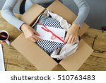 woman packaging a christmas... | Shutterstock . vector #510763483