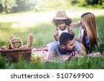 family picnicking outdoors with ... | Shutterstock . vector #510769900