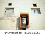 Abandoned Rusty Phone Booth By...