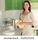 beautiful young woman in apron... | Shutterstock . vector #510919243