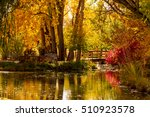 small pond with wooden bridge... | Shutterstock . vector #510923578