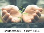 growing a plant. hands holding... | Shutterstock . vector #510944518
