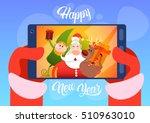 santa claus with reindeer elfs...   Shutterstock .eps vector #510963010