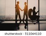 silhouettes of handshake of two ... | Shutterstock . vector #511064110