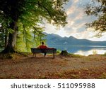 Man Sit On Wooden Bench At...