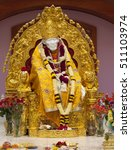Small photo of MILPITAS, CA- USA NOVEMBER 2015 - Hindu god Shirdi Sai Baba idol in Hindu temple. Sai Baba was an Indian spiritual master who was and is regarded by his devotees as a saint, fakir, and sat guru