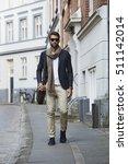 man walking in city wearing... | Shutterstock . vector #511142014