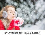 Happy Woman Blowing Snow...