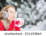 Happy Woman Blowing Snow...