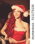 young beautiful smiling santa... | Shutterstock . vector #511173130