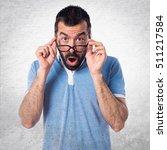 man with blue shirt doing...   Shutterstock . vector #511217584
