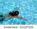 Closeup Of A Little Girl Swims...