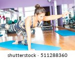 young woman getting into shape... | Shutterstock . vector #511288360