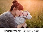beautiful young woman with her... | Shutterstock . vector #511312750