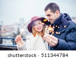 couple holding sparklers on... | Shutterstock . vector #511344784