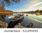 Calm Lake With Rowboat In...