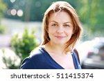 portrait of woman smiling... | Shutterstock . vector #511415374