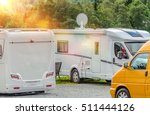 RV Park Campers. Few Motorhomes in the RV Park. Motorhome with Satellite TV Connection. - stock photo