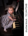 baby and piano  | Shutterstock . vector #511447048