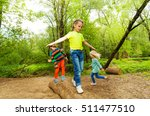 kids standing on a log and...   Shutterstock . vector #511477510