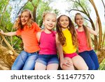 four happy girl friends sitting ... | Shutterstock . vector #511477570