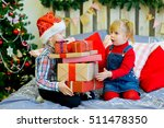 boy and girl give gifts near a... | Shutterstock . vector #511478350