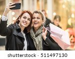 in the city  mother and... | Shutterstock . vector #511497130