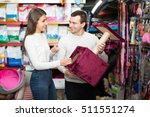 Stock photo portrait of happy european couple purchasing pet kennels in petshop 511551274