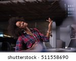 young black woman at her... | Shutterstock . vector #511558690