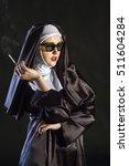 nun in glasses is smoking....   Shutterstock . vector #511604284