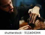 the barber a man with a beard... | Shutterstock . vector #511604344