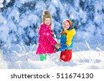 children play in snowy forest.... | Shutterstock . vector #511674130