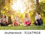 four beautiful female friends... | Shutterstock . vector #511679818