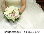 bride holding flower bouquet  | Shutterstock . vector #511682170
