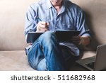 casual young man writing some... | Shutterstock . vector #511682968