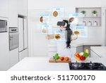 young woman cooking in the... | Shutterstock . vector #511700170