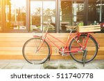vintage red bicycle at the city ... | Shutterstock . vector #511740778