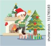 boy decorating christmas tree | Shutterstock .eps vector #511780183