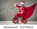 superhero child rides a bike.... | Shutterstock . vector #511793614