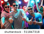 group of guys dancing near the... | Shutterstock . vector #511867318