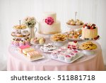 table with loads of cakes ... | Shutterstock . vector #511881718