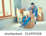 happy young couple unpacking or ... | Shutterstock . vector #511959328