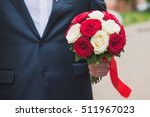 groom holding a bouquet of... | Shutterstock . vector #511967023