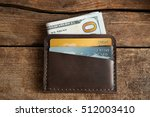 leather wallet on wooden... | Shutterstock . vector #512003410